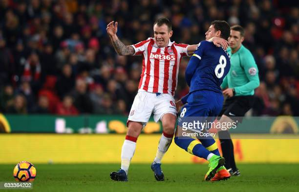 Glenn Whelan of Stoke City is challenged by Ross Barkley of Everton during the Premier League match between Stoke City and Everton at Bet365 Stadium...
