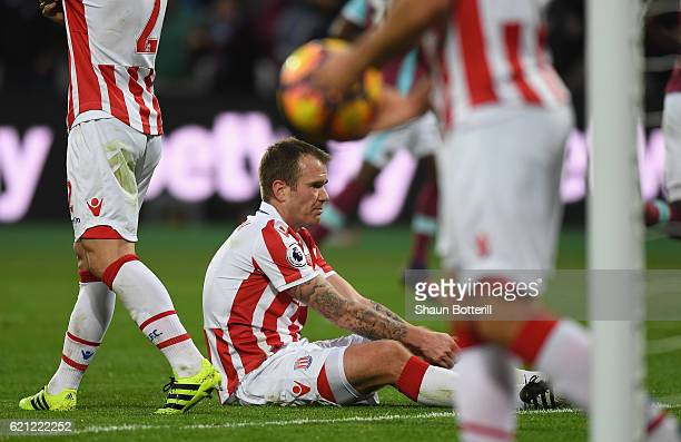 Glenn Whelan of Stoke City looks dejected after scoring a home goal during the Premier League match between West Ham United and Stoke City at Olympic...