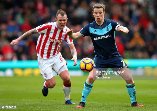 Glenn Whelan of Stoke City puts pressure on Grant Leadbitter of Middlesbrough during the Premier League match between Stoke City and Middlesbrough at...