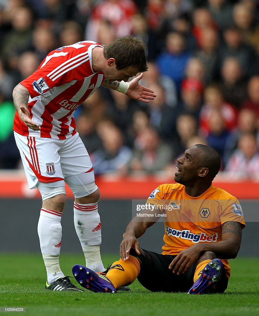 Glenn Whelan of Stoke City reacts to <a gi-track='captionPersonalityLinkClicked' href=/galleries/search?phrase=Ronald+Zubar&family=editorial&specificpeople=1295892 ng-click='$event.stopPropagation()'>Ronald Zubar</a> of Wolverhampton Wanderers during the Barclays Premier League match between Stoke City and Wolverhampton Wanderers at the Britannia Stadium on April 7, 2012 in Stoke on Trent, England.