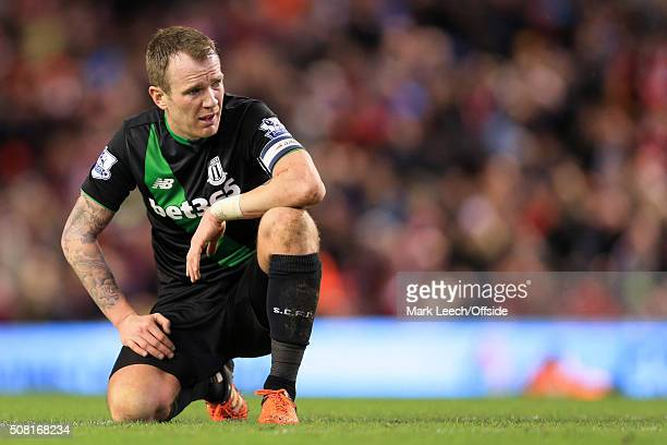 Glenn Whelan of Stoke looks dejected during the Capital One Cup SemiFinal Second Leg match between Liverpool and Stoke City at Anfield on January 26...