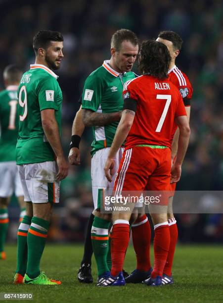Glenn Whelan of the Republic of Ireland and Joe Allen of Wales clash during the FIFA 2018 World Cup Qualifier between Republic of Ireland and Wales...