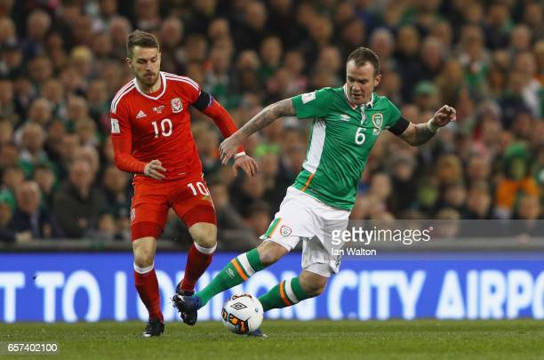 Glenn Whelan of the Republic of Ireland evades Aaron Ramsey of Wales during the FIFA 2018 World Cup Qualifier between Republic of Ireland and Wales...