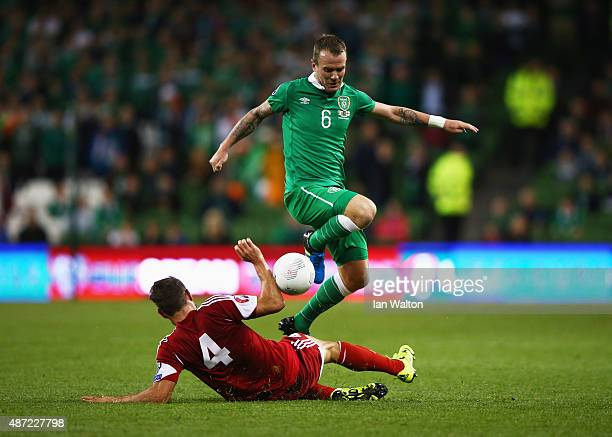 Glenn Whelan of the Republic of Ireland is challenged by Guram Kashia of Georgia during the UEFA EURO 2016 Group D qualifying match between Republic...