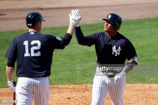 Gleyber Torres of the New York Yankees celebrates after hitting a solo home run in the sixth inning against the Detroit Tigers during a spring...