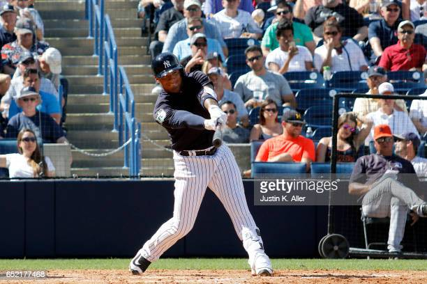 Gleyber Torres of the New York Yankees hits a solo home run in the sixth inning against the Detroit Tigers during a spring training game at George M...