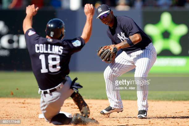 Gleyber Torres of the New York Yankees turns a double play to end the game against the Detroit Tigers during a spring training game at George M...