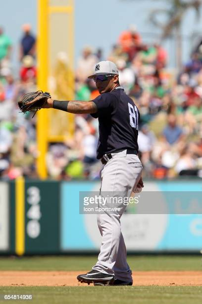 Gleyber Torres of the Yankees throws the ball across the field during the spring training game between the New York Yankees and the Detroit Tigers on...