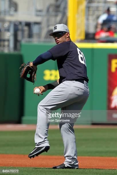 Gleyber Torres of the Yankees throws the ball across the infield during the spring training game between the New York Yankees and the Philadelphia...