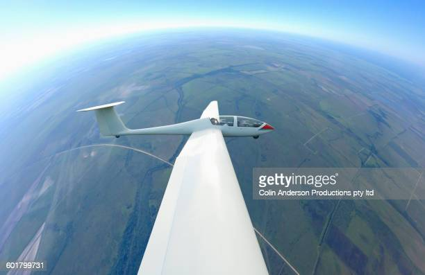 Glider airplane flying in sky