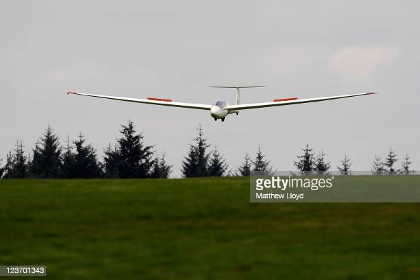 A glider comes into land at the Yorkshire Gliding Club which lies on a plateau in the North Yorkshire Moors National Park on September 1 2011 in...