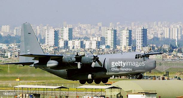 C130 glides in for a landing in front of downtown Adana March 7 2003 at Incirlik Air Force Base in Turkey Activity at Incirlik one of the Air Force's...