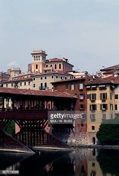 Glimpse of the town and Ponte Vecchio or Ponte degli Alpini over the Brenta river designed by Andrea Palladio in 1569 Bassano del Grappa Veneto Italy