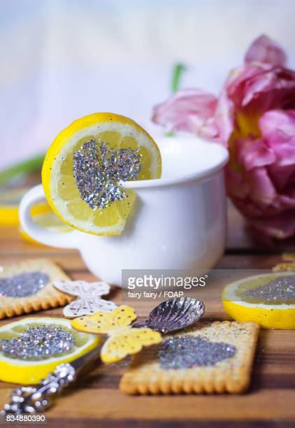 Glitter heart on lemon slice and biscuit
