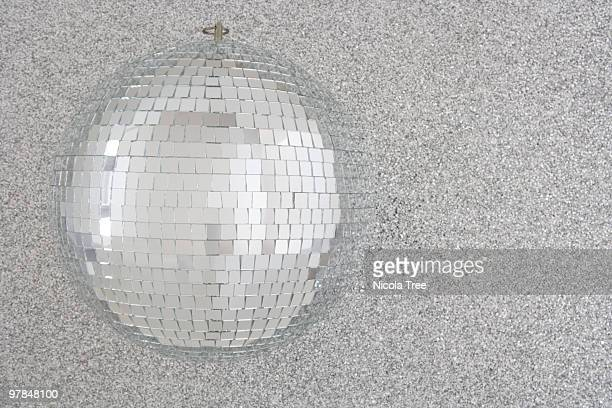 A Glitterball on a sparkling silver backround