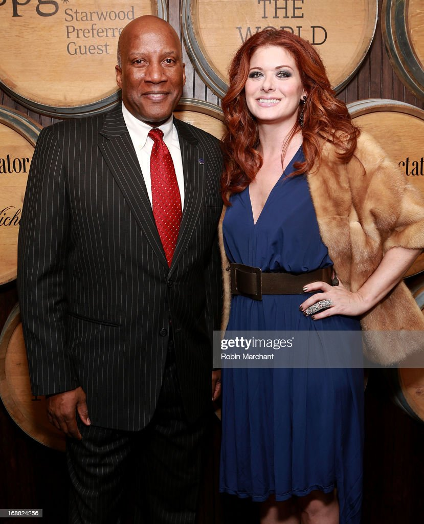 Global Brand Leader of Sheraton Hotels and Resorts Hoyt Harper (L) and Actress Debra Messing attend 'Toast Around The World' Celebration at New York Sheraton Hotel & Tower on May 15, 2013 in New York City.