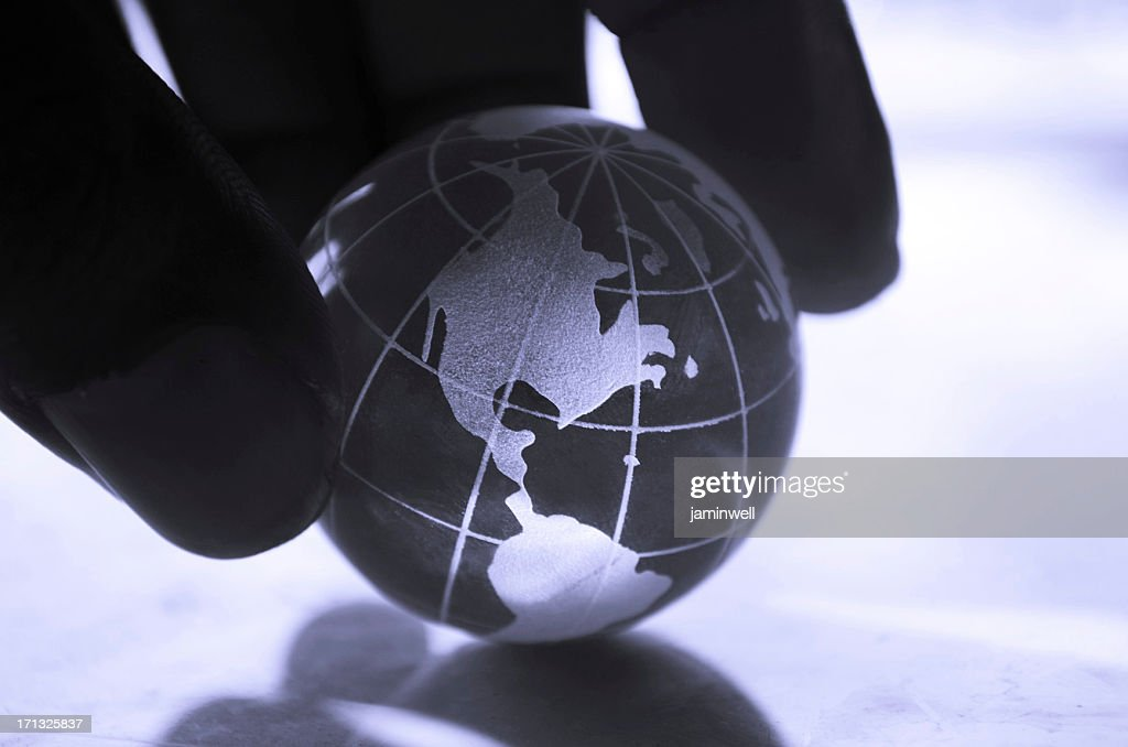 global concept; a firm dark hand in control of world : Stock Photo