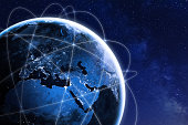 Global connectivity concept with worldwide communication network connection lines around planet Earth viewed from space, satellite orbit, city lights in Europe, some elements from NASA (https://eoimag