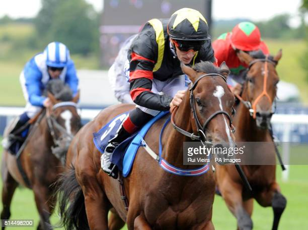 Global Giant ridden by Fran Berry wins The Weatherbys EBF Stallions Maiden Stakes during Gentleman's Day of The Moet and Chandon July Festival at...