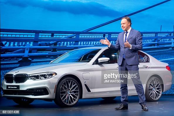 BMW Global Head of Sales and Marketing Dr Ian Robertson unveils the BMW 5 Series during the 2017 North American International Auto Show in Detroit...