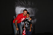 Global icon and footballing legend David Beckham greets 11 year old Ayaan Nadeem at the opening of the new adidas HomeCourt concept store in the Mall...