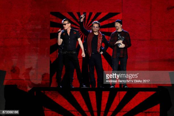 Global Icon award winners Adam Clayton Larry Mullen Jr Bono and The Edge of U2 are seen on stage during the MTV EMAs 2017 held at The SSE Arena...
