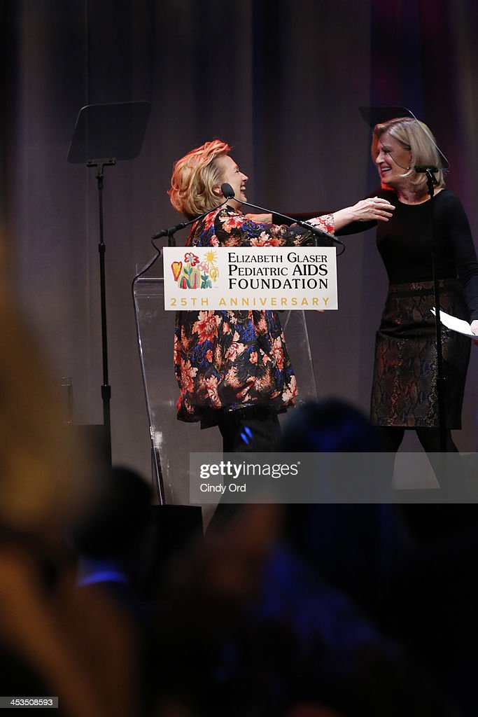 Global Impact Award Recipient Hillary Rodham Clinton and Journalist <a gi-track='captionPersonalityLinkClicked' href=/galleries/search?phrase=Diane+Sawyer&family=editorial&specificpeople=202252 ng-click='$event.stopPropagation()'>Diane Sawyer</a> greet each other on stage during Elizabeth Glaser Pediatric AIDS Foundation's Global Impact Award Gala Dinner Honoring <a gi-track='captionPersonalityLinkClicked' href=/galleries/search?phrase=Hillary+Clinton&family=editorial&specificpeople=76480 ng-click='$event.stopPropagation()'>Hillary Clinton</a> at Best Buy Theater on December 3, 2013 in New York City.