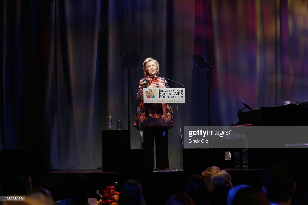 Global Impact Award Recipient Hillary Rodham Clinton speaks during Elizabeth Glaser Pediatric AIDS Foundation's Global Impact Award Gala Dinner Honoring <a gi-track='captionPersonalityLinkClicked' href=/galleries/search?phrase=Hillary+Clinton&family=editorial&specificpeople=76480 ng-click='$event.stopPropagation()'>Hillary Clinton</a> at Best Buy Theater on December 3, 2013 in New York City.