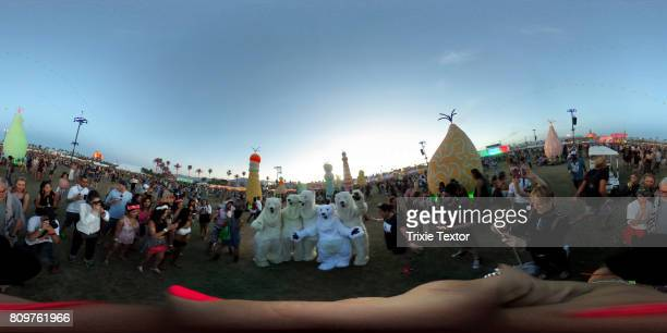 Global Inheritance polar bears pose for photos surrounded by festivalgoers during day 2 of the Coachella Valley Music And Arts Festival at the Empire...