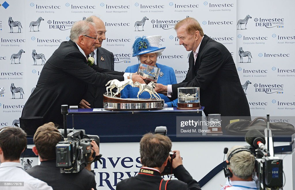 Global Managing Director of Investec Bernard Kantor, His Highness The Aga Khan, Queen <a gi-track='captionPersonalityLinkClicked' href=/galleries/search?phrase=Elizabeth+II&family=editorial&specificpeople=67226 ng-click='$event.stopPropagation()'>Elizabeth II</a>, and horse trainer Dermot Weld, pose in the winners enclosure after horse 'Harzand' won the Investec Derby during Derby Day at the Investec Derby Festival, celebrating The Queen's 90th Birthday, at Epsom Downs Racecourse on June 4, 2016 in London, England.