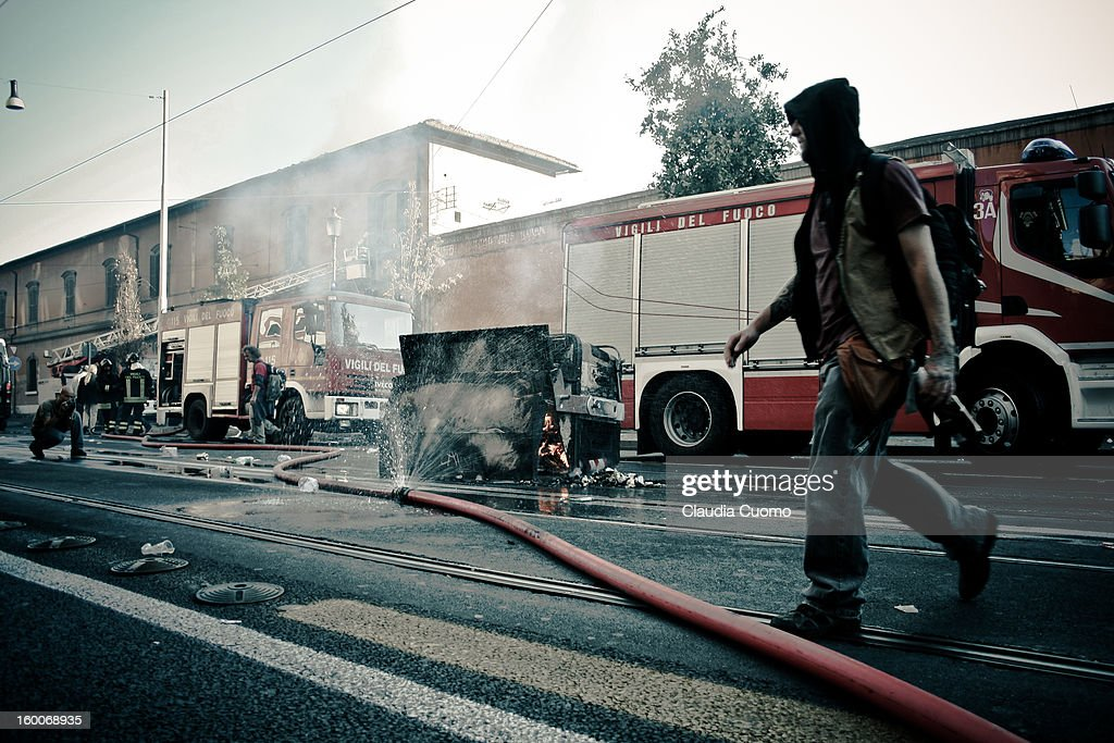 CONTENT] Global Manifestation in Rome, October 15th 2011. A demonstrate crosses the street outside the Defense Ministry, whose offices had just been extinguished from fire set by a paper bomb.