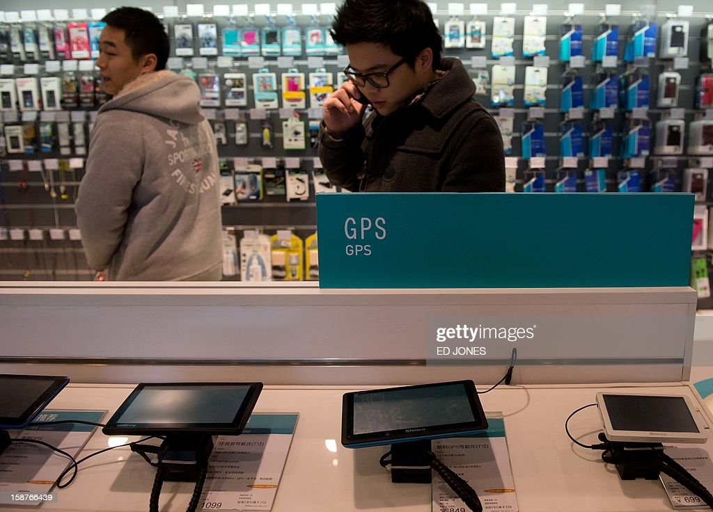 Global Positioning System (GPS) units are displayed at a shop in Beijing on December 28, 2012. China has launched commercial and public services across the Asia-Pacific region on its domestic satellite navigation network built to rival the US global positioning system. AFP PHOTO / Ed Jones