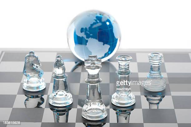Global strategy concept with glass chess set