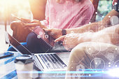 Global Strategy Virtual Icon Innovation Graph Interfaces.Young Coworkers Team Analyze Meeting Online Report Electronic Gadgets.Businessmans Startup Digital Project.Tablet Hands Laptop.Closeup Blurred