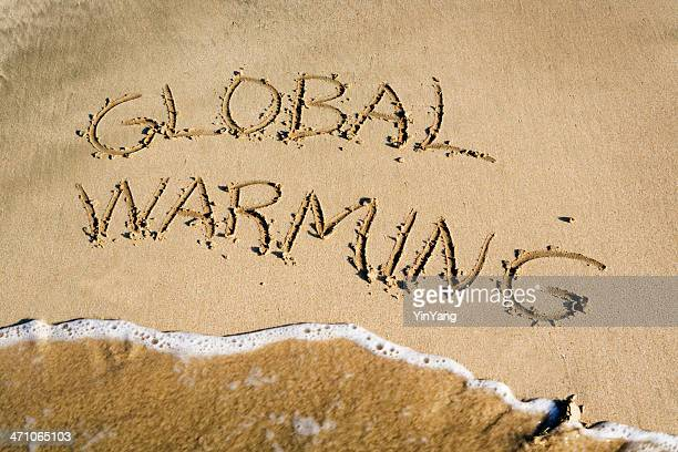 Global Warming, Climate Change Message Written in Sand by Sea