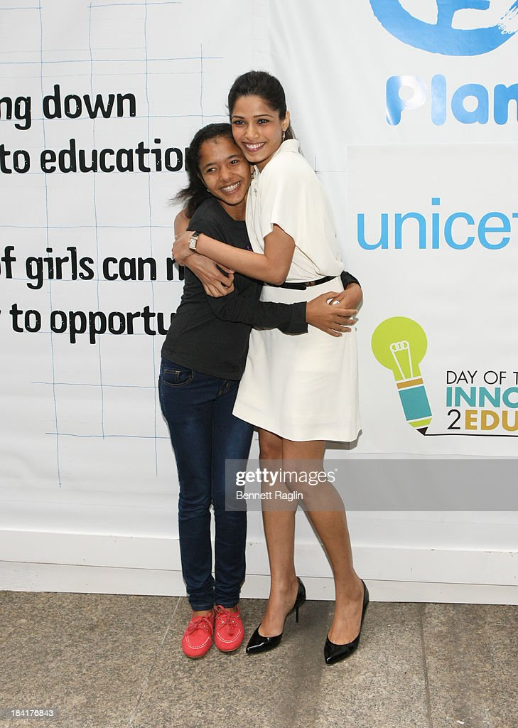 Global Youth Ambassador Tulsi Thappa and actress Frieda Pinto attend 'Day Of The Girl' Fresco Unveiling With Freida Pinto at UNICEF House on October 11, 2013 in New York City.