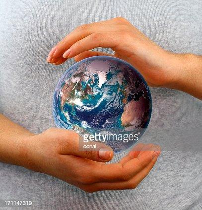 Globe between hands