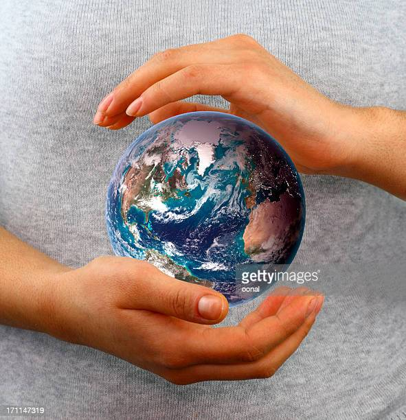 Globe between hands