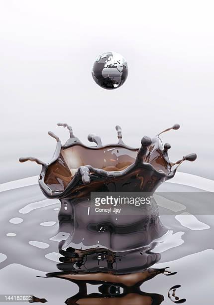 CGI globe droplet splashing in crude oil
