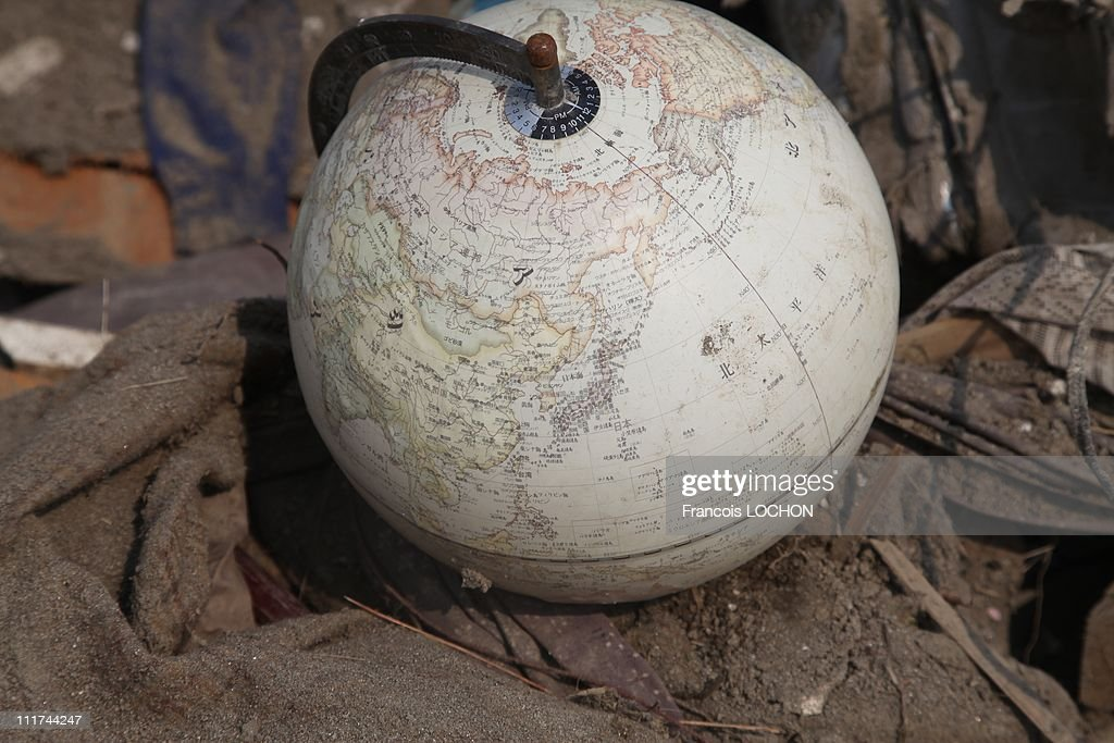 A globe is left in the rubble destroyed by the earthquake on April 4,2011, in Yamda,Japan. These objects are from the 30 000 victims of the earthquake that hit Japan on March 11, 2011 followed by an tsunami.