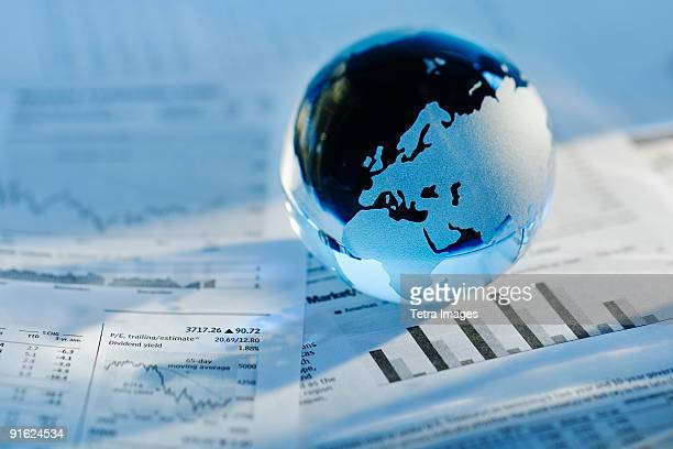 A globe on business papers