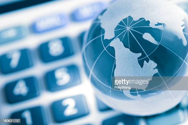 Globe on calculator, america map