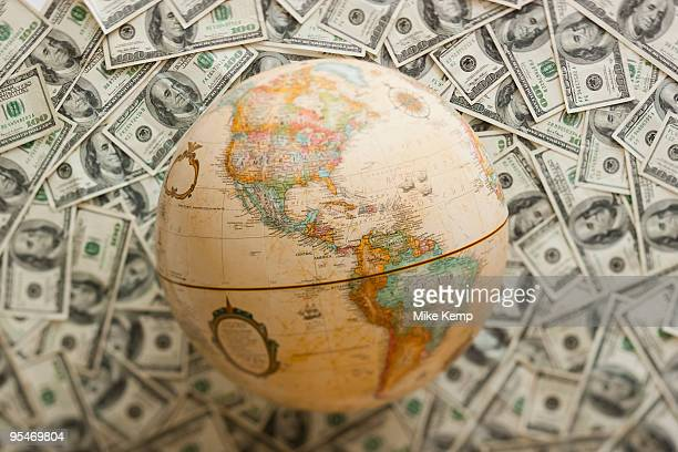 Globe on US dollars background