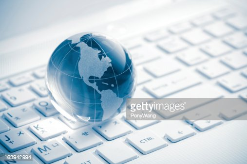 Globe showing Americas on white keyboard