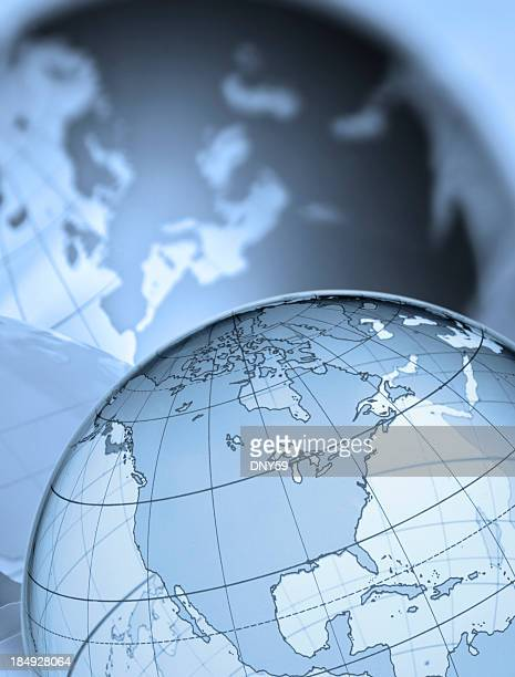 Globe showing North America shadow of Europe in the background