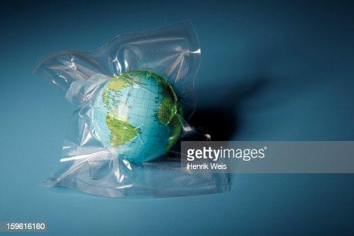Globe shrink wrapped in plastic