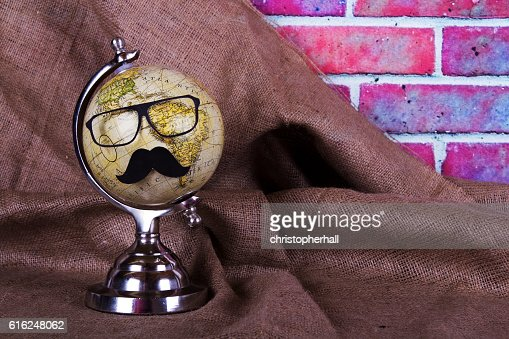 Globe with a black hipster mustache : Foto de stock