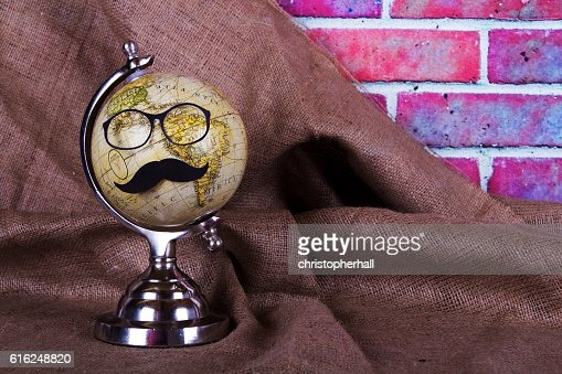 Globe with a black hipster mustache : Stock Photo