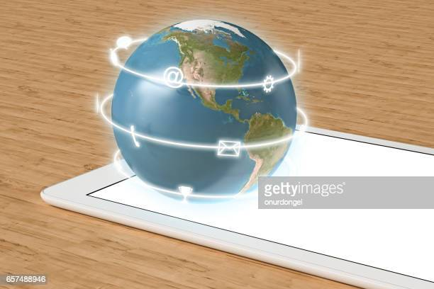 Globe with  app icons on tablet computer