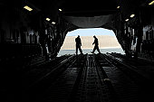 January 20, 2010 - C-17A Globemaster III loadmasters go through prefight checks on the ramp prior to loading cargo for an airlift mission at a forward operating base in Southwest Asia.